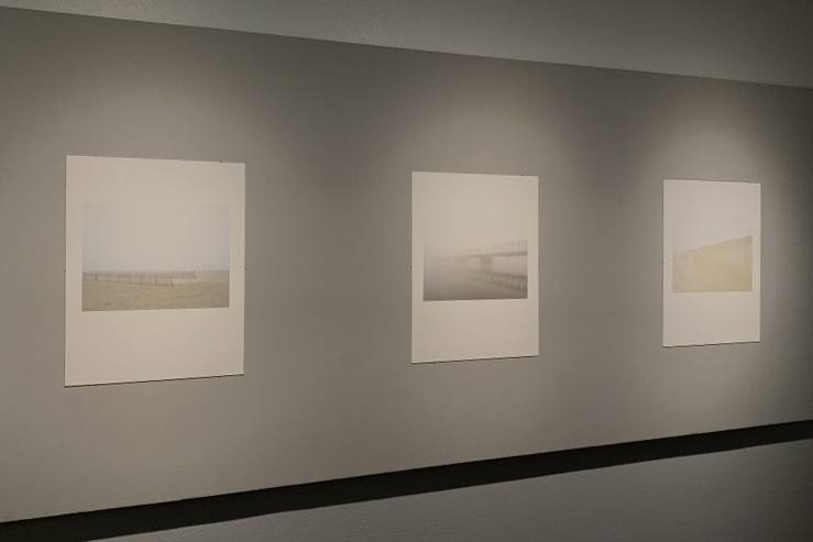Three of Mark Ludak's photographs hang on the walls of the Irene Carlson Gallery.
